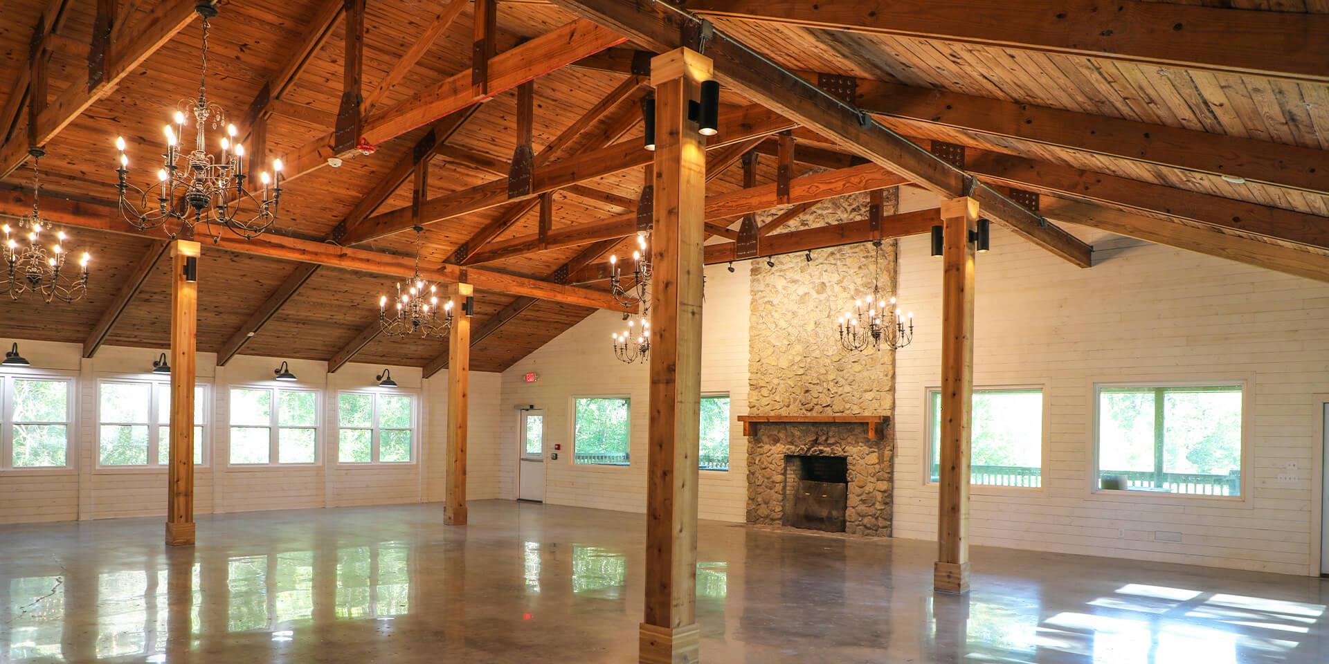 Wide shot of the spacious Sherlock Springs Lodge, showcasing the charismatic Pine Ceiling with Rustic Chandeliers