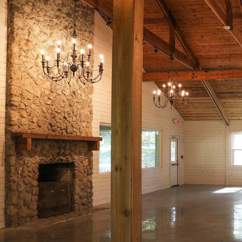 View of the floor-to-ceiling stone fireplace inside the Sherlock Springs Lodge